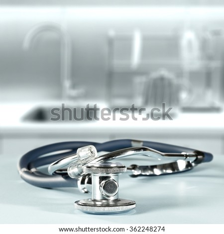 background of blurred hospital interior with blue and silver tool of doctor