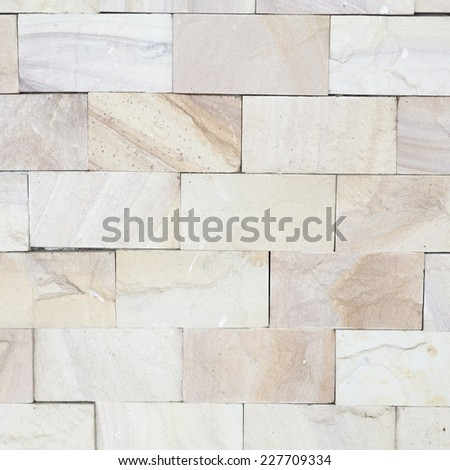 Background of brick wall Tiles stacked neatly. Wall of residential house - stock photo