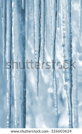 Background of bright transparent icicles in the sunlight - stock photo