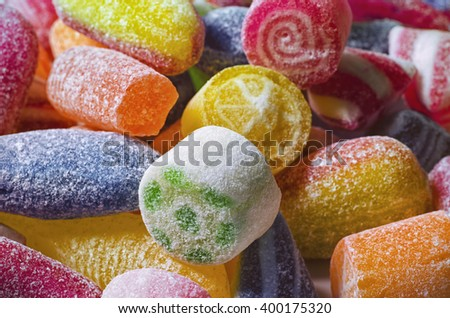 Background of brightly-coloured sweets/candy; close up image of sugar-coated candy; differential focus  - stock photo