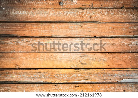 Background of brown old natural wood planks Dark aged empty rural room with tree floor pattern texture Closeup view to golden surface of retro pine logs inside vintage light warm interior with shadows