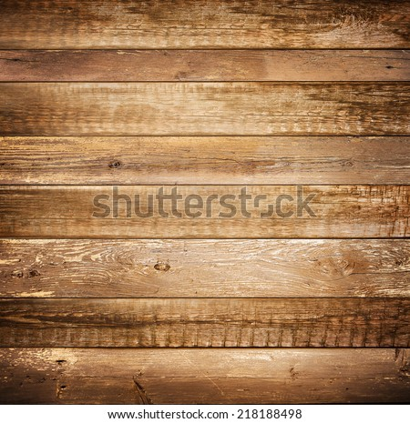 Background of brown old natural wood planks Dark aged empty rural room with tree floor pattern texture Closeup gold view surface of retro pine red logs inside vintage light warm interior with shadows - stock photo