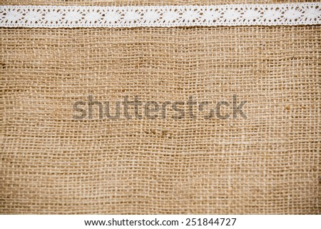 Background of canvas with white cotton lace