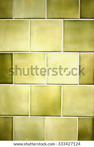 Background of ceramic wall tiles in shades of green - stock photo