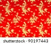 Background of chinese red silk with dragon and phoenix - stock photo