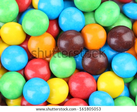 Background of chocolate balls in colorful glaze. Whole background