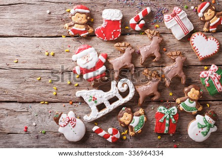 Background of Christmas gingerbread in the form of toys on a wooden table. horizontal view from above