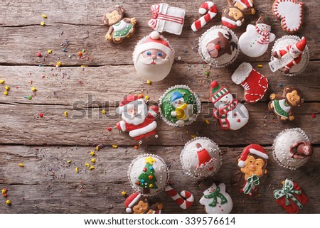 Background of Christmas sweets on a wooden table. horizontal view from above