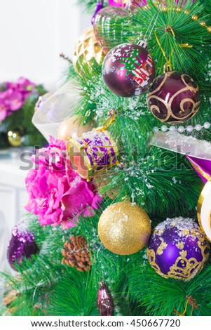 Background of christmas tree decorated with christmas baubles, chain, flowers, ribbon and snow - stock photo