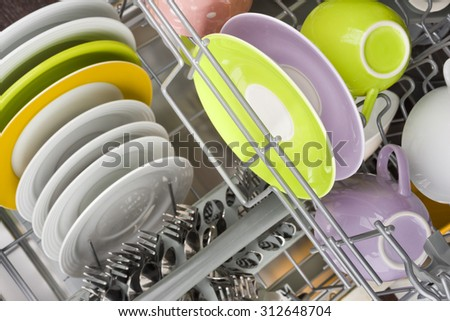 Background of clean dishes in dishwashing machine, top view - stock photo