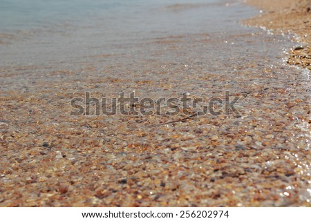 Background of clean sea-water and sand at the bottom - stock photo