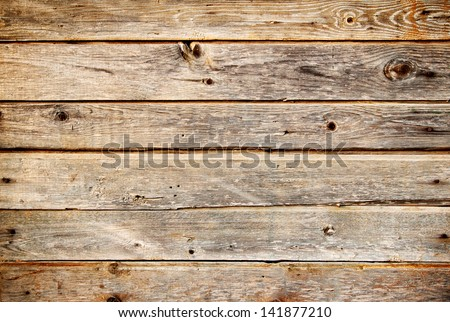 Background of coarse dark planks with knots - stock photo