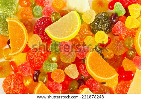 Background of colorful fruity candies and jelly close up - stock photo