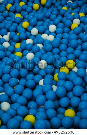 Background of colorful plastic balls for kids to play on the playground