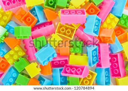 Background of colorful plastic brick toys - stock photo