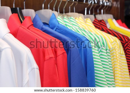 background of colorful polo shirt on a hanger - stock photo
