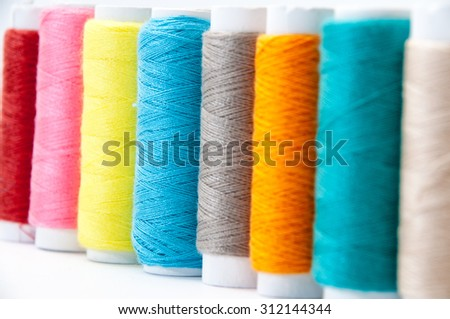 Background of colorful sewing thread.