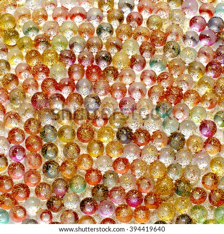 background of colorful shiny balls. round balls with glitter - stock photo