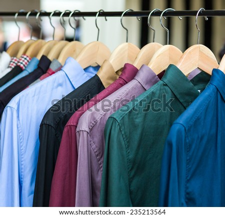 background of colorful shirt on a hanger - stock photo