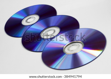 Background of compact disks or dvds - stock photo