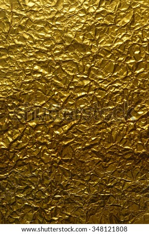 Background of crumpled gold paper - stock photo