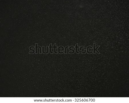 Background of dark textured glass