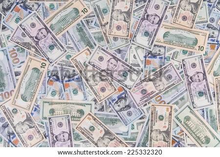 Background of different dollar bills - stock photo