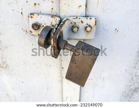 Background of door with lock in metal material - stock photo