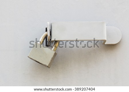 Background of door with lock in metal material and  on wall. - stock photo