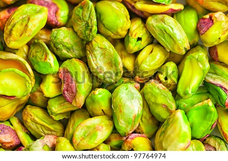 background of dried pistachio nuts - stock photo