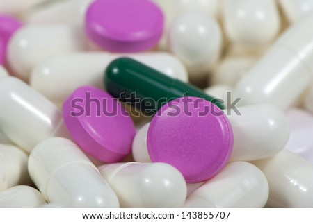 Background of drugs in soluble capsules closeup