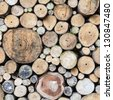 Background of dry logs stacked up on top of each other - stock photo