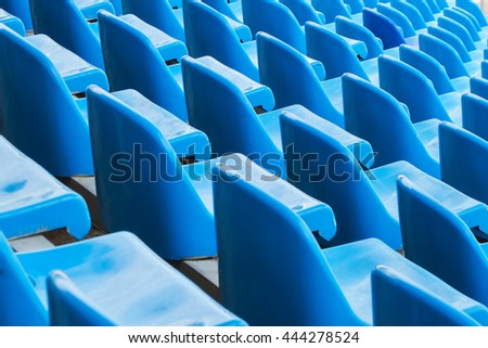 Background of empty blue seats in a stadium - stock photo