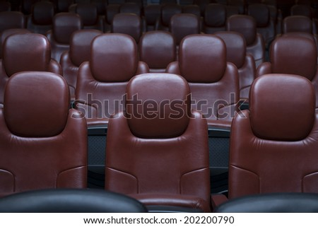 Background of Empty Brown Cinema Chairs - stock photo