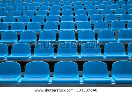 Background of empty seats in a stadium - stock photo