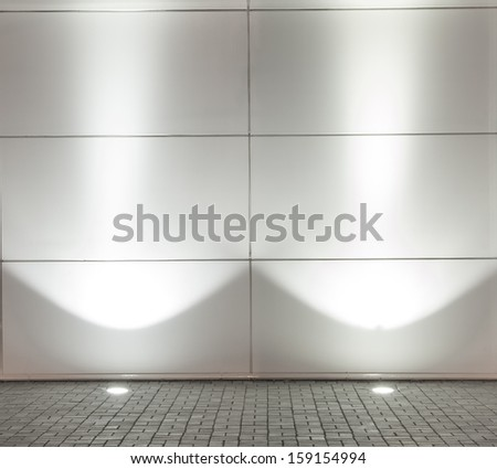 Background of Empty white wall with 2 spot lights and gray stones brick floor - stock photo