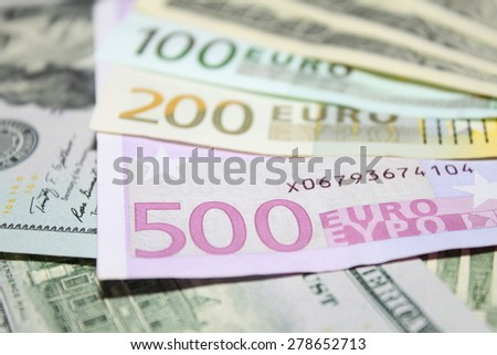 Background of euro and dollar bills. USD EUR banknotes close-up. Shallow focus.
