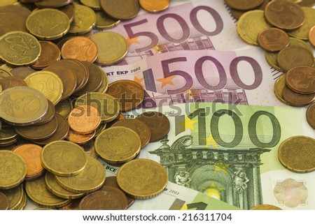 Background of euro bills and coins, european money, cash, Euro money: closeup of banknotes and coins, 500 euro - stock photo