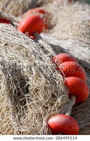 Background of  Fishing Net Pile with red Floats  - stock photo