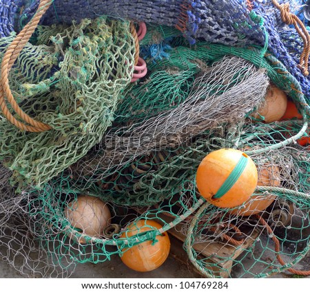 Background of fishing nets and floats - stock photo