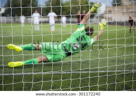 background of football goalkeeper  jumping for the ball