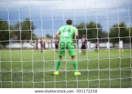 background of football goalkeeper with front of gates net  - stock photo