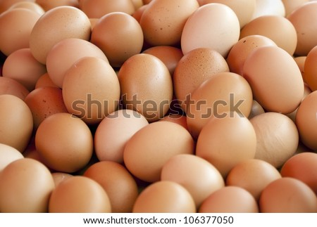 background of fresh eggs for sale at a market - stock photo