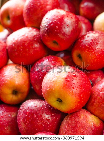 Background of fresh red apple with drop  - stock photo
