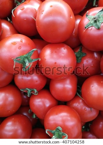 background of fresh ripe organicred tomatoes on display at local farmer's market departmental store - stock photo