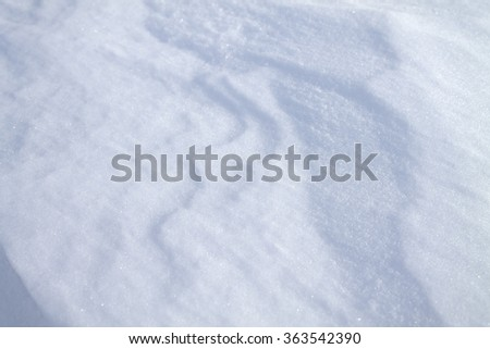 background of fresh snow texture in blue tone/the texture of snow/snow cover - stock photo