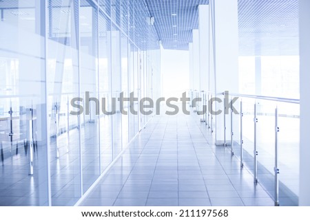 Background of glass corridor in office centre Backdrop of floor roof wall in perspective - stock photo