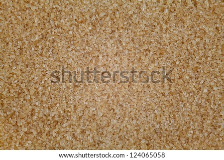 background of golden brown granulated demerara sugar - stock photo
