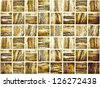 Background of Golden Mosaic Texture, spacious vintage room with stone and glass tiled grungy wall - stock photo