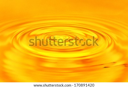 background of golden water - stock photo